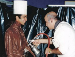 A street performing artist sprayed with chocolate surprised guests when he suddenly moved during a service.
