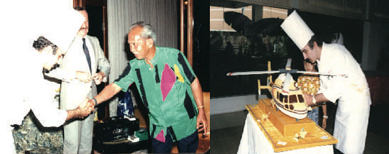 Just before presenting the Malaysian King Iskandar with a helicopter birthday cake.