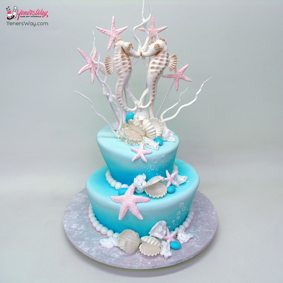 Beach Theme Wedding Cake With A Surfing Couple Topper