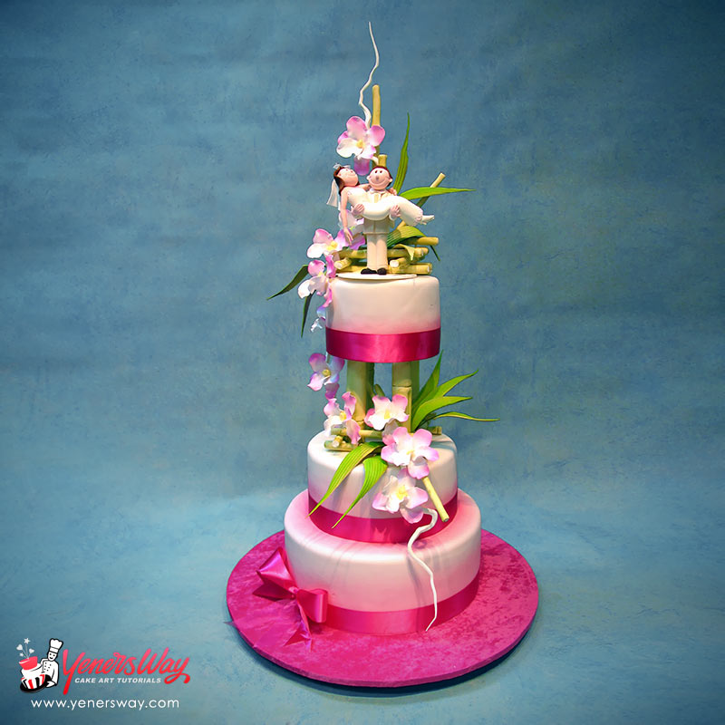 Bamboo And Orchids Wedding Cake With Funny Couple Yeners Way