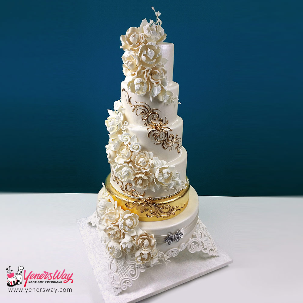 Cascading-Foral-Bouquets-with-Golden-Tier-Wedding-Cake